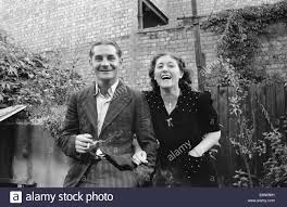 Mrs Elsie Smith and her husband outside an Anderson shelter in her Stock  Photo - Alamy