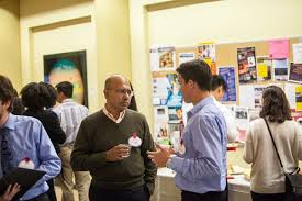 Pratap Mukharji ' 91 talks with a student at the networking reception  following the Fords in Business Conference.   Haverblog
