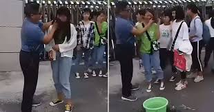 teacher forcefully wipes off