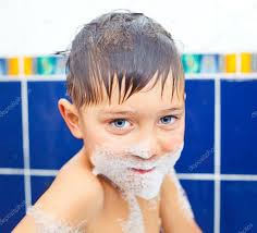 cute boy in bathroom stock photo
