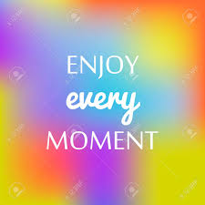 motivational quote rainbow blurred background enjoy every moment