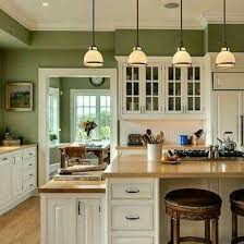 white cabinets with green wall color
