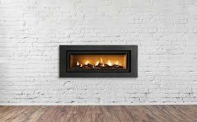 gas fireplace on white brick wall in