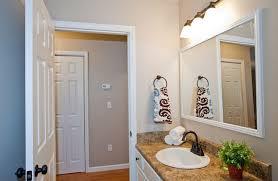 bathroom mirror with white frame