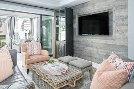 pink and gray living room with tv niche