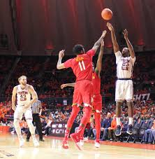 Aaron Jordan connects on a three-pointer over two Maryland defenders -  Illini Report