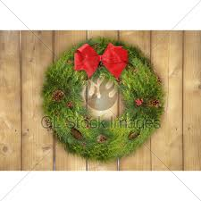 Christmas Wreath On A Rustic Wood Fence Gl Stock Images