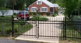 A Driveway Fence Gate Adds Curb Appeal Long Fence