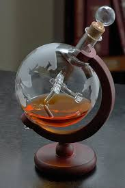 etched world globe whiskey decanter w