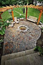 brick patio fire pit with pergola