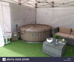 Inflatable hot tub in garden gazebo Stock Photo - Alamy
