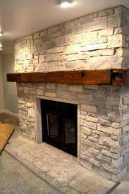 barn fireplace beam mantel