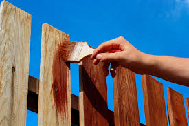 Tips On How To Properly Paint A Wood Fence Action Fence