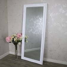 large ornate white wall leaner mirror