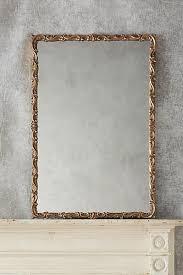 brass swirls sculptural frame mirror