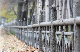 Gray Blue Metal Fence With Peeling Paint In The Long Run As A Stock Photo Picture And Royalty Free Image Image 68999815