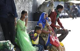 Indian authorities provide transportation for migrant workers to ...