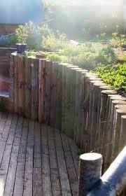 cedar log retaining wall rock garden