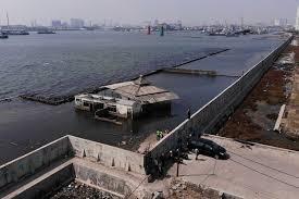 sinking jakarta needs giant sea wall president
