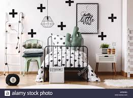 Cactus Pillow On Bed With Patterned Overlay In Kids Room With White Ladder And Poster On Wall Stock Photo Alamy