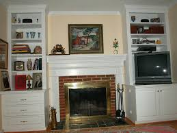 bookcases for either side of fireplace