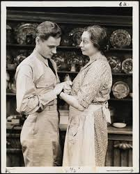 "Museum of the City of New York - [William Prince as Private Quizz West and  Aline MacMahon as Nell West in Act 1, Scene 1 of ""The Eve of St. Mark"".]"