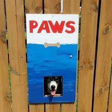 These Dogs Like To Look At Their Neighborhood Through A Hole In A Fence So Their Owners Put Up Posters To Make Their Neighbors Laugh Bored Panda