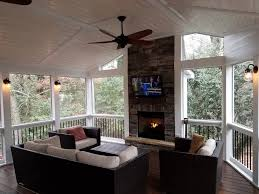 screened porch with fireplace and wall
