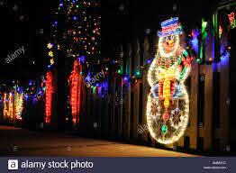 Christmas Lights Outdoor Display With Snowman And Candy Canes On Stock Photo Alamy