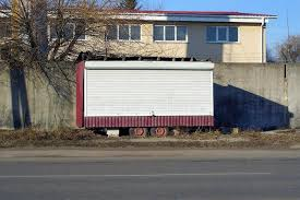 One Trailer With White Shutters On Wheels Stands On The Street Near A Gray Fence Stock Photo Image Of Blinds Exterior 170733716