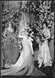 Peggy Hamilton with actresses Priscilla Dean and June Marlowe modeling  wedding attire at the Cocoanut Grove, Los Angeles, 1929 — Calisphere