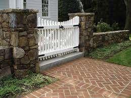 Found On Bing From Landscapingame Blogspot Com Stacked Stone Walls Stone Columns Picket Gate