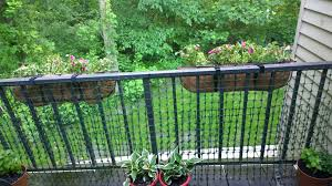 If Your Balcony Railing Has Slats That Are Too Wide Add Plastic Chicken Wire Use Twist Ties To Attach It The Ra Chicken Fence Balcony Railing Garden Spaces