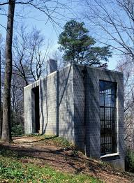 concrete block house with wall of glass