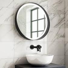 illuminated black frame round mirror