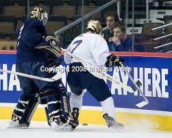 Brad Phillips (Notre Dame - 30), ?, Aaron Palushaj (Michigan - 8), Shawn  Hunwick (Michigan - 31) | HockeyPhotography.com