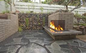 outdoor fireplace in retaining wall