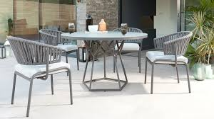 porto round glass garden table and ivy