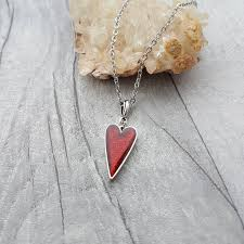 small red heart shaped pendant with