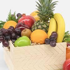 seasonal fruit gift basket hand