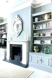 tv nook above fireplace ideas