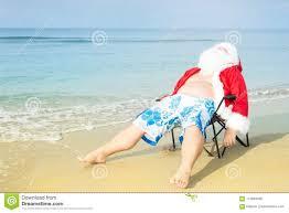 funny santa in shorts on the beach
