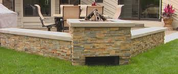 concrete patio with stone fireplace