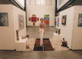 Alana Lewis with her work at a Central Coast Campus art exhibition. |  Living Histories