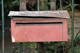 Red Letterbox On The Iron Fence The Mailbox With A Slot Into Which Mail Is Placed Stock Photo Download Image Now Istock