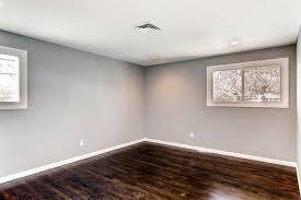 gray walls white baseboards dark