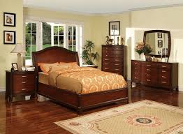 bedroom with cherry furniture