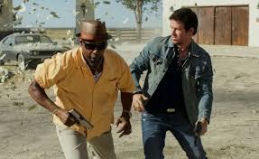 I Cani sciolti Washington e Wahlberg sono due agenti infiltrati e  concorrenti