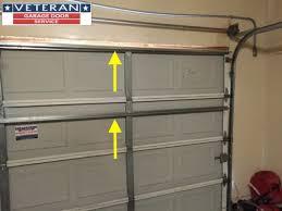 strut or replace my garage door section