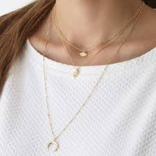 gold triple layer horn and charms